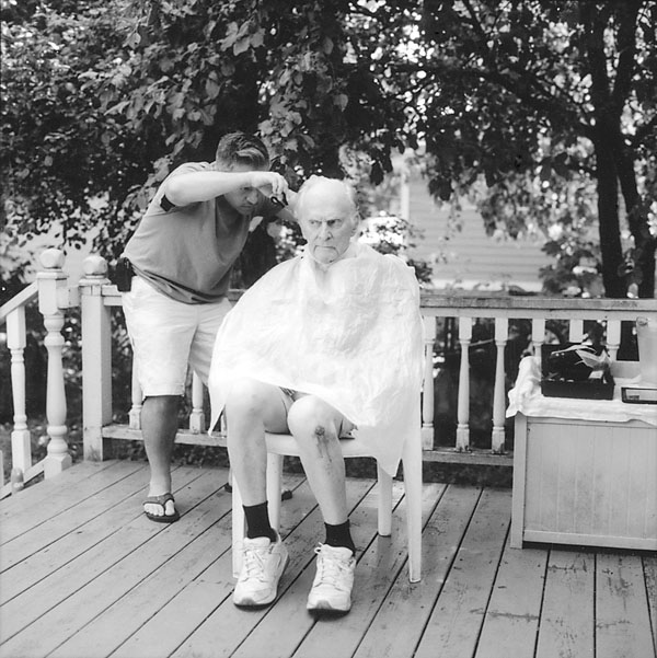 Patrick Burgess gives my dad a haircut.
